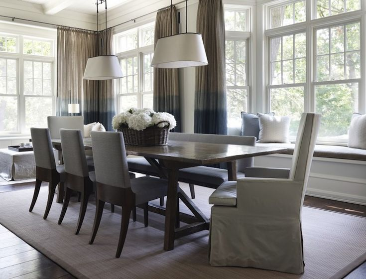 Blue and gray dining room with built in window seat and