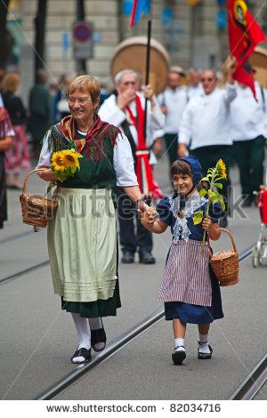 ZURICH - AUGUST 1: Swiss National Day parade on August 1, 2009 in Zurich, Switzerland. Representative of canton Uri marching in traditional costumes. - stock photo