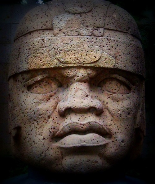 Olmec colossal heads, massive basalt monuments each weighing between 6 an 50 tons (sculpted in what is now Mexico ~1500–400 BCE)