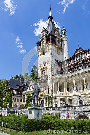 Peles castle with unidentified visitors on July 24, 2013 in Sinaia, Romania. Given its historical and artistic value, Peles castle is one of the most important and beautiful monuments in Europe.