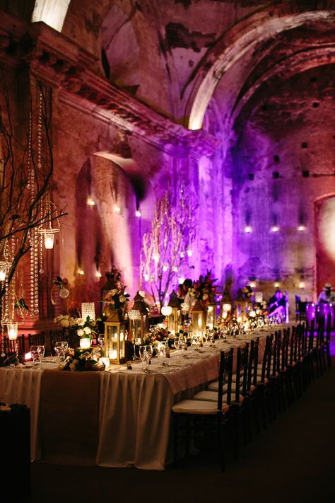 What a great room. Love the shadowing, purple uplighting with the Manzanita, only our tables will look more like haunted mansion style without flowers.