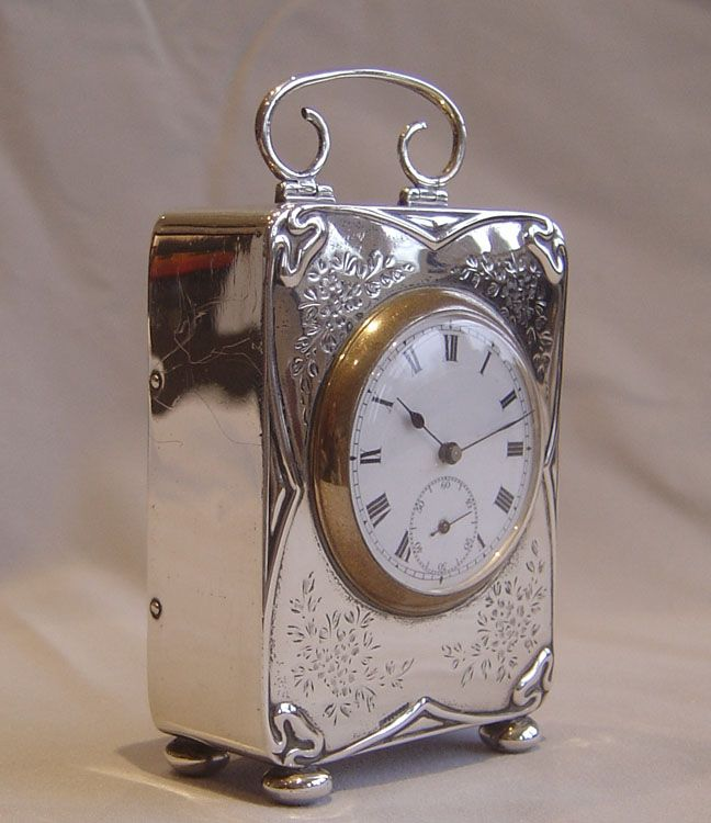 Antique Art Nouveau silver cased carriage clock.
