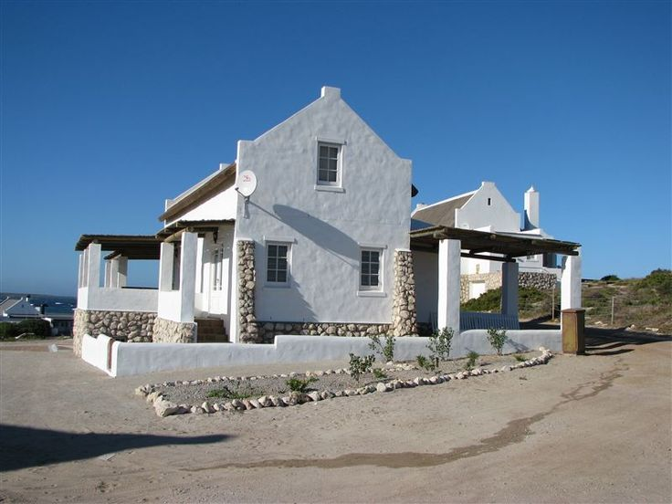 Sandkorrel - As if it were alone shepherding the seas, Sandkorrel is surrounding by sand, and beach on three sides and accessed by road on the other, in the quiet coastal town of Jacobs Bay.  Situated on a dune in ... #weekendgetaways #jacobsbay #southafrica