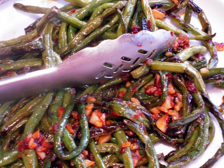 Szechuan-style Yard Long beans in a spicy, garlicky sauce. If you like chili sauces like Sambal Oelek, this recipe looks like a very simple one to try. And I can't pass up another opportunity to say how easy and rewarding it is to grow your own Yard Long beans!