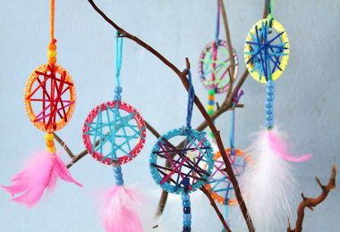 Dreamcatcher   Sophie's World - made out of a child's bracelet, yarn, beads, and feathers