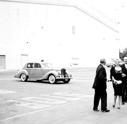 """A rare photograph of Marilyn Monroe arriving with George Cukor to the Kruschev banquet, 1959. """