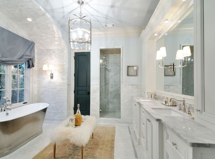 Neutral Natural Stone Makes For A Stunning Centerpiece In This Bathroom  Completed By @levantinausa.