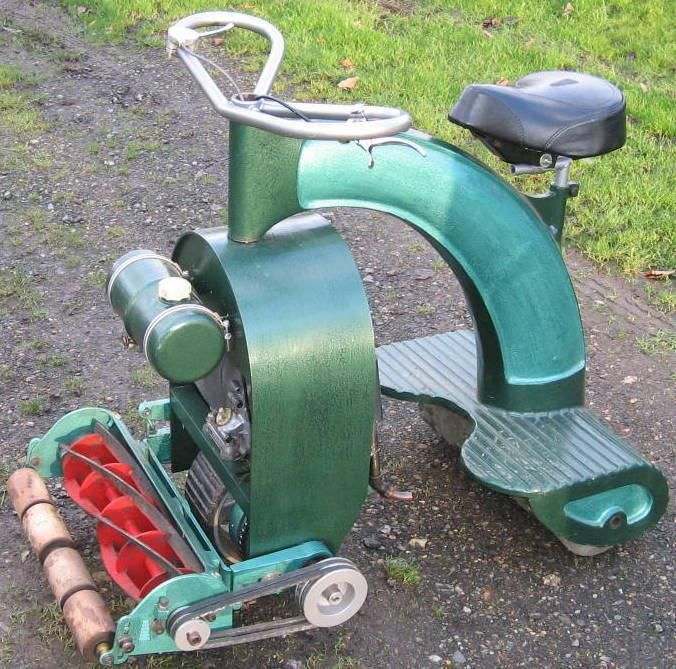 Vintage 3 wheel ride on mower... click...