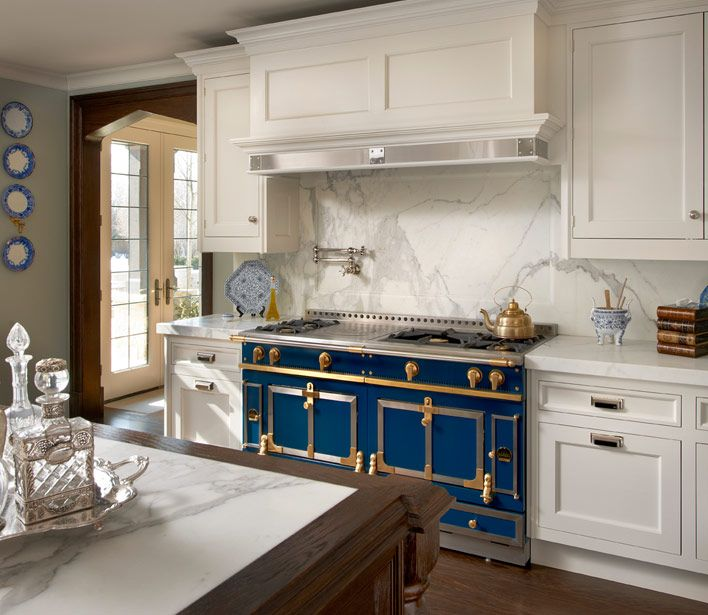 O'Brien Harris: Modern French kitchen with La Cornue Chateau Range paired with white wood paneled ...