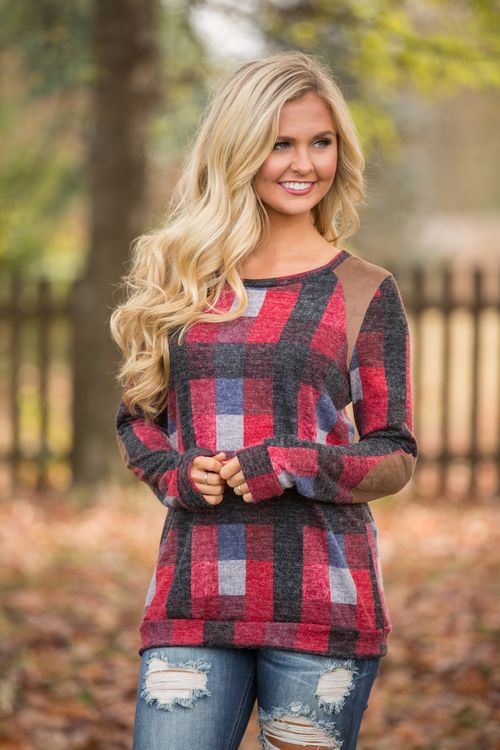 This unique geometric print pullover is sure to keep you cozy and stylish all season long!