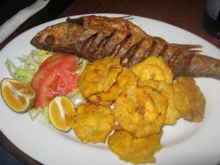 fried fish, plantains and vegetables.
