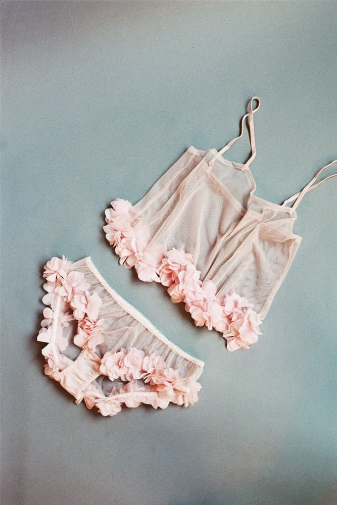 This fabulous set is made from sheer pink tulle and features a delicate pink petal trim. Knickers are made in a classic full brief shape and have t...