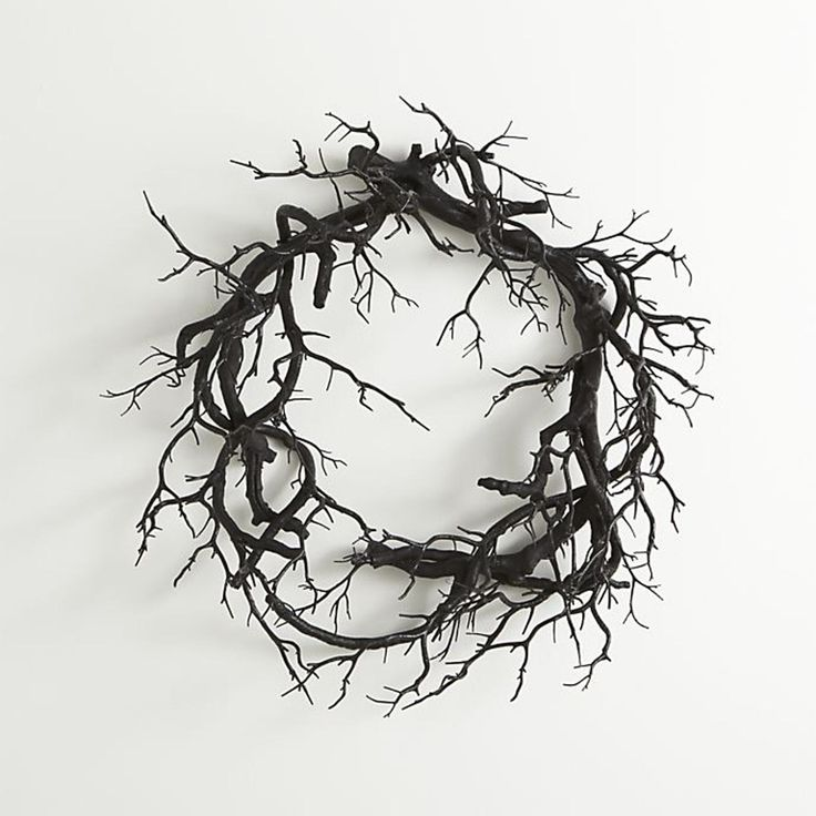 Black branch artificial wreath - 10 chic Halloween decorating ideas