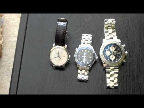 Swiss automatic watch collection.  From left to right, Baume & Mercier Classima Executives, Omega Seamaster Professional and Breitling Super Avenger.