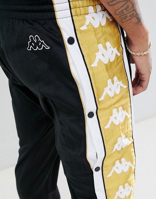 5316b6ff50f2b Kappa | Kappa joggers with popper hem and large logo taping in black & gold