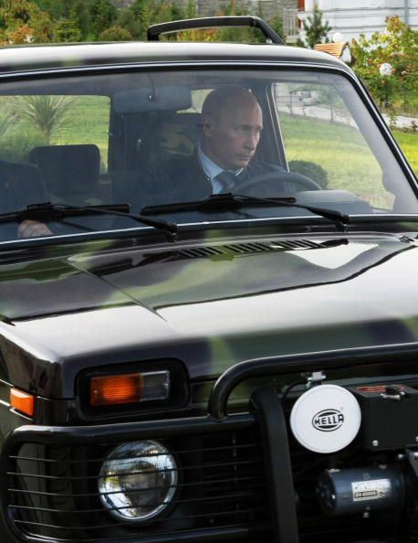 Russian Prime Minister Vladimir Putin drives his Lada Niva offroad car in his summer residence in Sochi on May 16 2009 AFP PHOTO / RIA NOVOSTI / POOL...