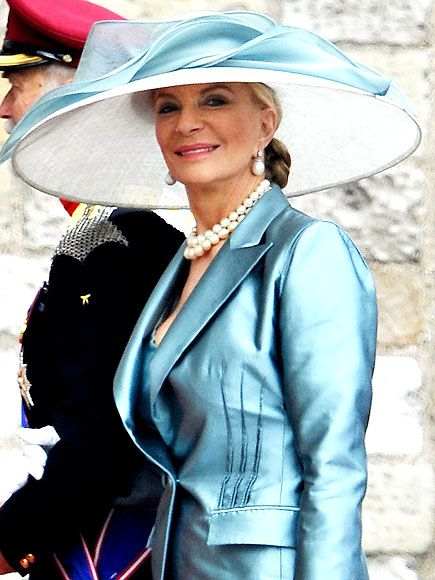 PRINCESS MICHAEL OF KENT    Accompanying her husband Prince Michael of Kent, the royal family member adds a swath of teal organza to her white hat.