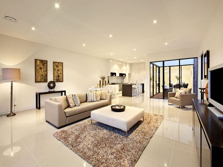 Open plan living room using beige colours with tiles & floor-to-ceiling windows - Living Area photo 131922