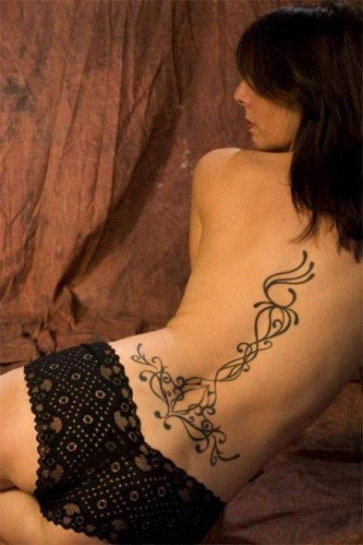 girl-have-back-black-ink-floral-tattoo