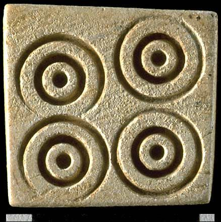 Fired steatite button seal with four concentric circle designs discovered at Harappa.    This paper examines the nature of Indus seals and the different aspects of seal iconography and style in the Indus civilization.: