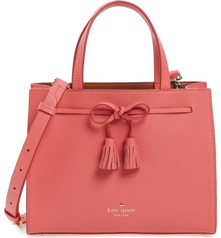 A tassel-tipped bow sets a polished tone on this pebbled leather satchel by Kate Spade featuring a well-organized, divided interior.