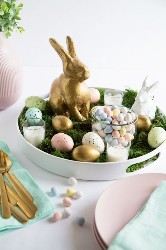 Create a beautiful Easter table with this handmade centerpiece. We've added a gold bunny, eggs, and moss to create this piece. You can use this DIY tray as a centerpiece or as an Easter decor piece on top of a buffet table or shelf. #easter #eastercrafts #eastercenterpiece #eastertablescape