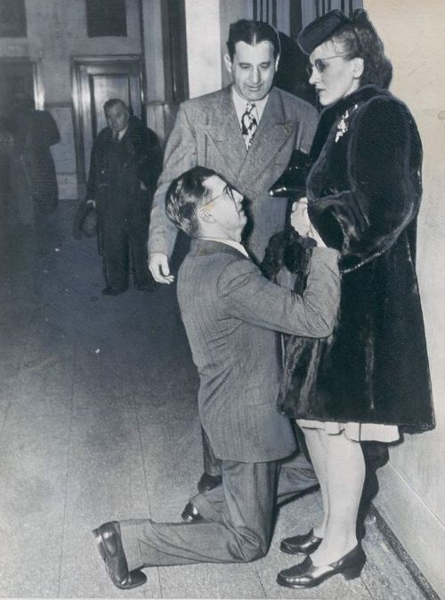A man begging for his wife's forgiveness inside Divorce Court. Chicago, 1948