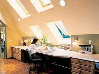 """No sharp pitch at our house though! """"The intersection between the sharply pitched ceiling and the low wall of this attic provides a perfect spot for a long built-in desk that functions as a craft center. Large, operable skylights that double as windows fill the area with natural light, making it perfect for detail work."""""""