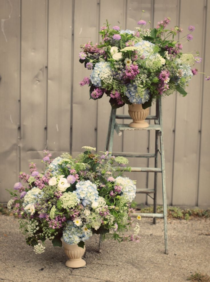 Large lush seasonal urns for on the altar