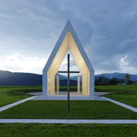This small family chapel in rural Austria by Gerhard Sacher has a white concrete shell and gables, which frame views of the rolling countryside
