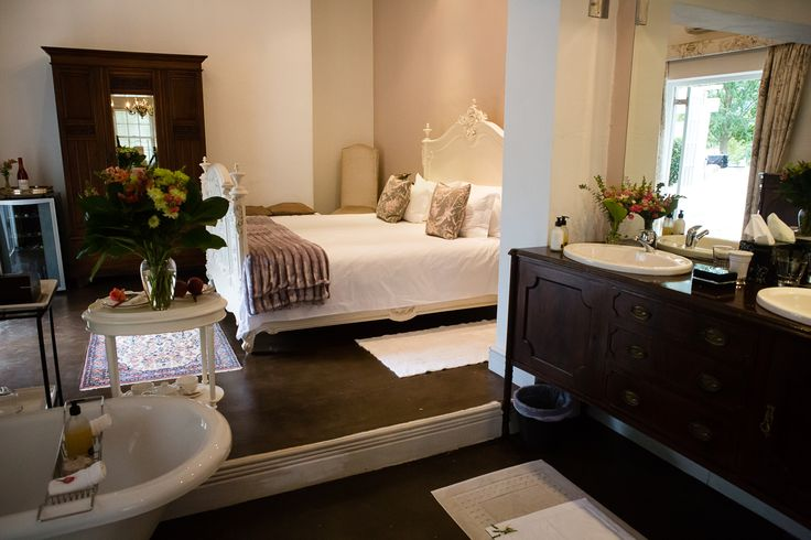Superior Suite - Room 8 overlooks the herb garden. This open plan bed & bathroom comforts you with an antique French king-size bed, percale linen, coffee & tea facilities, stocked mini bar and air-conditioning. The open plan bathroom has a freestanding claw foot bath, oversize shower for two and en-suite toilet. Private patio with water feature wall for your personal enjoyment.