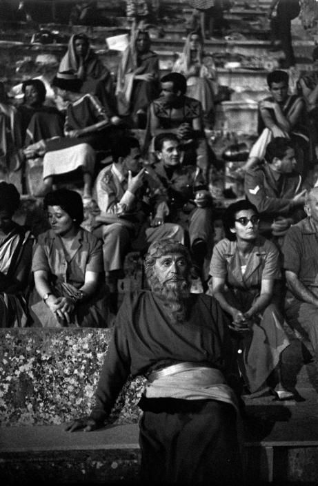 "Henri Cartier-Bresson - Peloponnese. Epidaurus. Theater festival. GREECE. 1961  ""Interval during the play 'Medea' (Maria CALLAS in the main role). Costumes designed by the Greek painter TSAROUCHIS"""