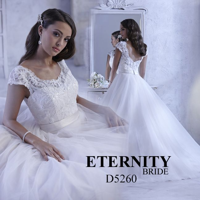 Ball gown wedding dress made with tulle over satin, delicate beaded bodice, capped sleeves and illusion back. D5260 is available in all Ivory, all White or Ivory Gold (as pictured). Call us to find your nearest retailer. #eternitybridal #eternitygroup #weddingdresses #bridal #brides #bridalgown #gettingmarried #weddingshopping #weddingdressshopping #bigday #weddingday #dresses #bigskirt #princessforaday #weddingday