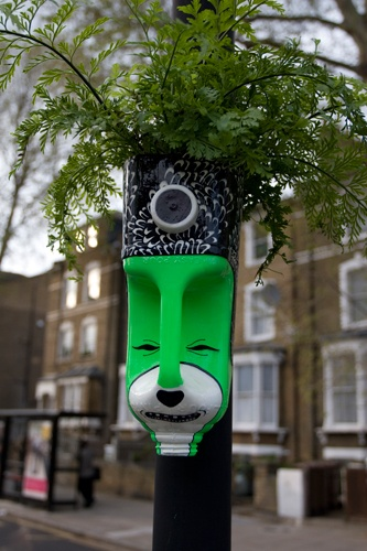 guerilla gardening puts these funky little planters on the street with #recycled plastic #bottles