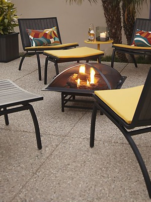 If your landlord allows it, a fire pit would keep your apartment balcony nice and toasty on chilly nights.  If it's against your lease, try candles or even LED lights for the glow without the flame!