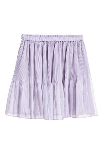 Vestido corto en punto grueso de algodón con motivo estampado. Modelo con tirantes finos ajustables, nudo decorativo en el pecho, cremallera oculta en la es