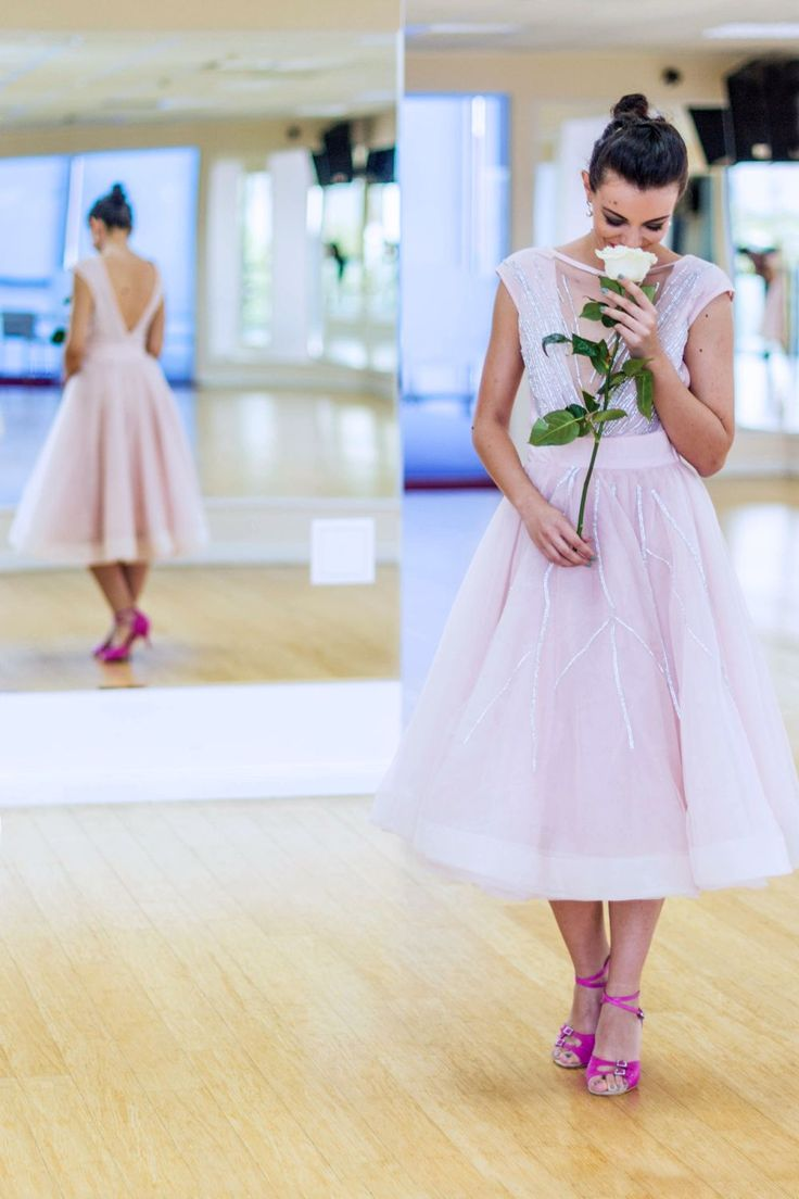 dancing in pink pale dress with white rose