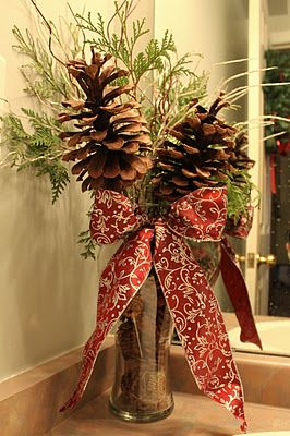 Floral pine cones in vase