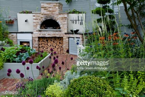 Kitchen garden with raised beds and wood burning stove. 'A Chef s Kitchen', Hampton Court Flower Show, 2009, designed by Karen Rogers. : Stock Photo