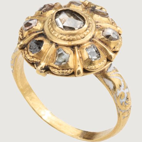 "LATE RENAISSANCE. Gold, enamel, DIAMOND CLUSTER RING WITH OPIUM COMPARTMENT. Spain?, about 1630–40. The compartment was intended to contain an opiate in some form or other. This use can be deduced from the form of the ring and its interior. The whole bezel t represents the poppy The presence of stars might indicate that a sleeping potion was the intended content. The Latin name of the opium poppy, papaver somniferum, means ""sleep-bringing poppy."