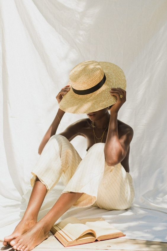 minimalist living with beige pants and straw hat