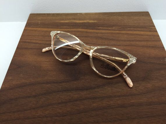 1980's Vintage Silhouette Iridescent Studded Cat Eye Glasses by blackandbluevintage on Etsy https://www.etsy.com/listing/220105679/1980s-vintage-silhouette-iridescent