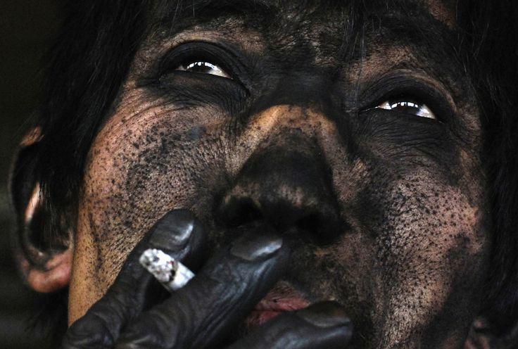 La raza humana en 24 fotos desgarradoras. El rostro de un minero de carbón chino.