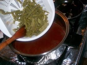 Tortitas de camaron en salsa roja con nopales (mexican shrimp fritters in red sauce with nopales cactus)