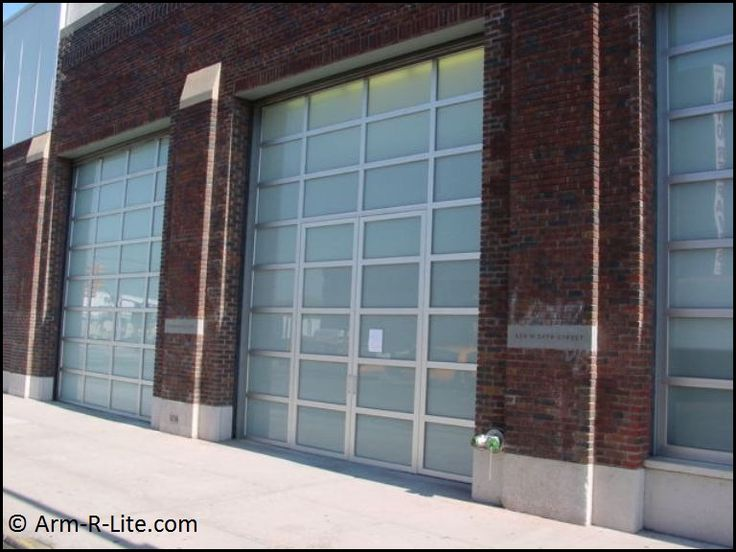 Gagosian glass garage doors by arm r lite with frosted for Opaque garage door