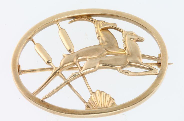 Lot 663, A stylish 9ct yellow gold open brooch by  Geoffrey Bellamy 11 grams, Est £200-250