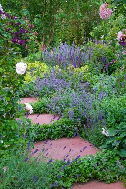 Usually you think of a walkway first and then perhaps add some plants. Here it seems as if the stepping stones are secondary to the lovely garden area!