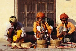 Snake Charmers in Rajasthan  These are the gypsy snake charmer caste of India. Cobras are very mystical to Indians as the ally to the Hindu God Shiva.