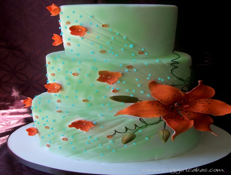 CAKE: To kind of give an idea of the decoration. It will be four oval layers, covered in sage green. The bouquet of tiger lilies will rest beside it and the etched lines and dots will radiate from the bouquet. It will all be on a large vintage oval shaped mirror with a gold frame. The cake will be at one end, leaving room for the bouquet at the other.
