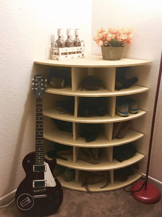 Pie-shaped, space saving, corner piece used for storing extra shoes, books, toys, or anything else you can imagine. Custom made for each